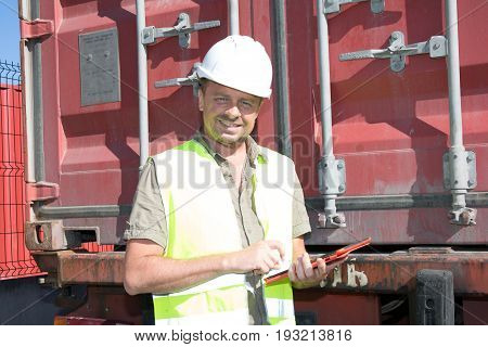 Man Hold Control Worker Of Loading Containers Box To Truck And  Pointing The Containers For Logistic