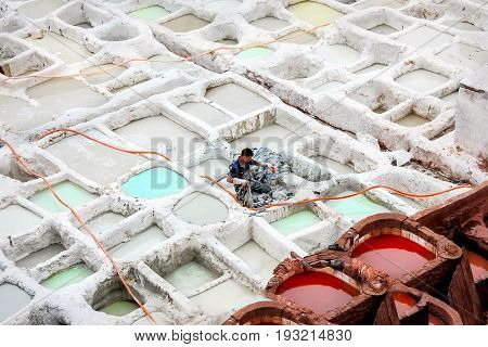 Morocco Fez the old city - September 15 2014: Worker paint the skin in dyers