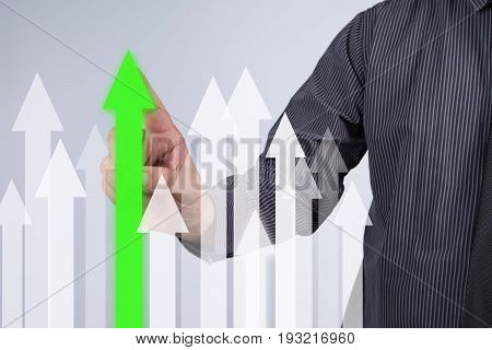 Sales Growth Graph - Businessman hand pressing button on touch screen interface. Business technology internet concept. Stock Photo