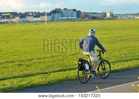 Claddagh Galway, Ireland June 2017,south Park, Man Riding His Bicycle In The Public  Park.