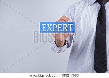 Businessman hand draw expert word. Business concept