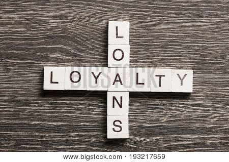 Business workplace with loyalty loans words on table