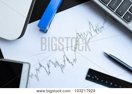 Financial graphs on office table. Studio shot
