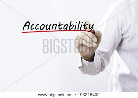 Businessman hand writing Accountability with red marker on transparent wipe board business concept
