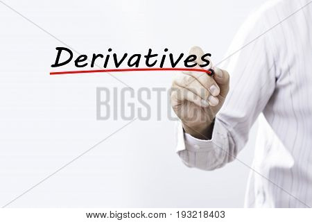Businessman hand writing Derivatives with red marker on transparent wipe board business concept