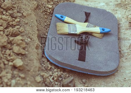 Archaeological tools (two brushes mat) on a land separation on archaeological excavations
