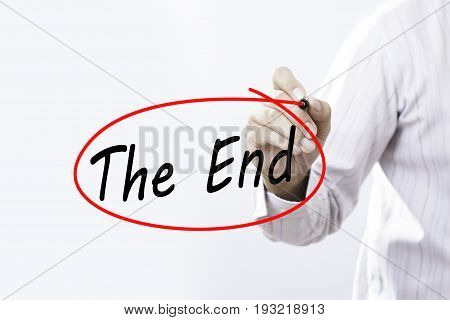 Businessmen Hand writing The End with marker on visual screen. Isolated on white. Business technology internet concept.