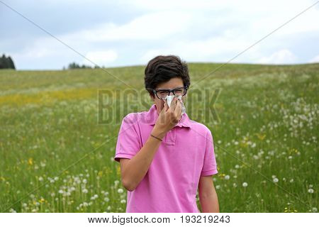 Allergic Adolescent With Glasses Blows His Nose