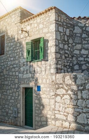 Facade Of A Stone House At Coastal Old Town