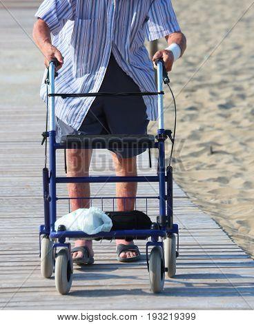Old Man Walks With Walker