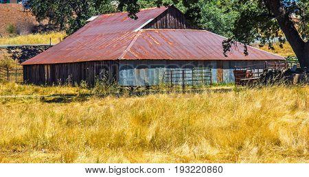 Wood & Tin Barn With Rusted Tin Roof
