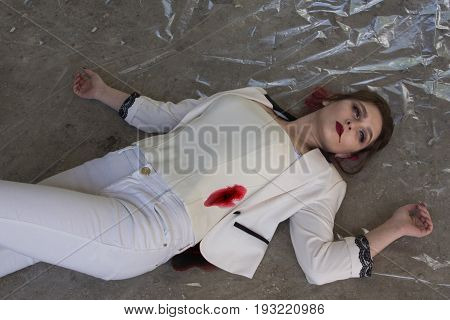 Crime Scene With Stabbed Fashion Woman In A Darkplace