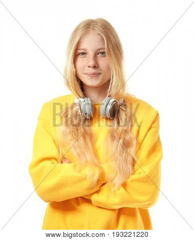 Cute teenager girl with headphones on white background