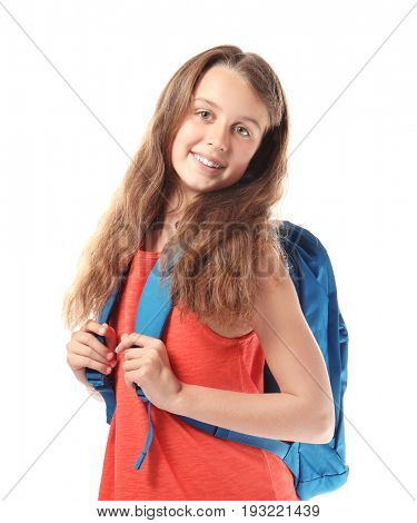 Cute teenager girl with schoolbag on white background