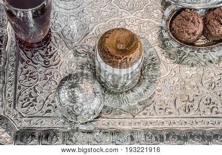 Turkish Coffee Served With Sherbet And Cookies In Traditional Copper Serving Set