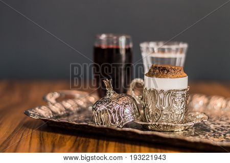 Turkish Coffee Served With Water And Sherbet In Traditional Copper Serving Set