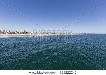 Blue summer sky and pacific ocean water at Venice Beach in Los Angeles, California.
