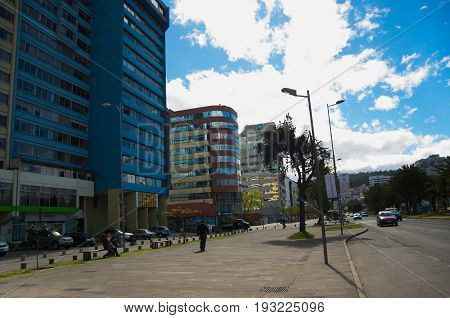 QUITO, ECUADOR - MAY 06 2016: Mainstreet in NNUU avenue with some buildings, cars and people in the city of Quito.