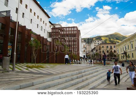 QUITO, ECUADOR - MAY 06 2016: Unidentified people walking in the colonial streets located in the city of Quito.