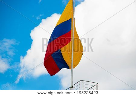 QUITO, ECUADOR - MAY 06 2016: Beautiful Ecuadorian flag in a sunny day at Plaza Grande in Quito, Ecuador.