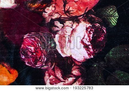 Knitwear fabric with floral abstract pattern of pink scarlet roses with green fresh leaves.