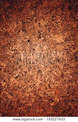 Closed up of brown corkboard texture background.