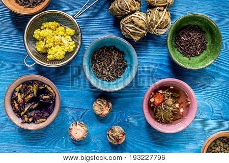 herbal and green tea for tea-house on gray wooden desk background flat lay pattern