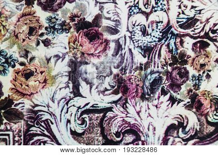 Knitwear fabric with elastane with floral abstract pattern of pink, orange, purple scarlet roses with leaves.