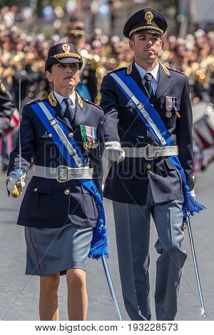 ROME ITALY - JUNE 2 2017: Military parade at Italian National Day. Man and woman commanders in front. Picture is taken between Piazza Venezia and Teatro di Marcello.