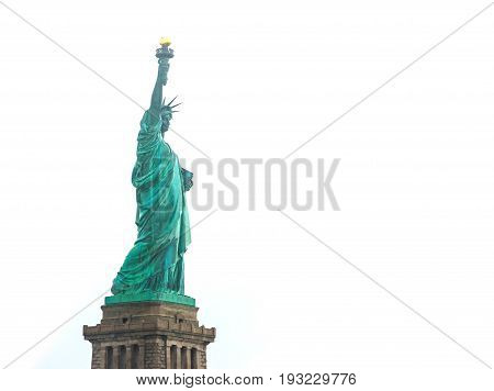 Statue of Liberty on Liberty Island in New York Harbor in New York City in the United States isolated on white.