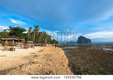 EL NIDO, PALAWAN, PHILIPPINES - MARCH 29, 2017: People on a wedding party in a beachfront restaurant at Las Cabanas Beach.
