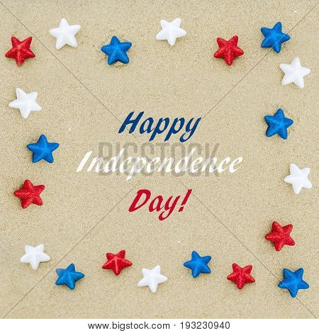 Independence USA background with white red and blue stars on the sandy beach square format
