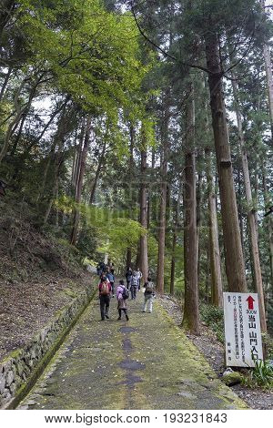 KYOTO JAPAN -NOV 22 2015: Tourists are walking up to Yoshiminedera temple in autumn. Yoshimine-dera is a temple of the Tendai sect of Japanese Buddhism and it is the twentieth temple on the Kansai