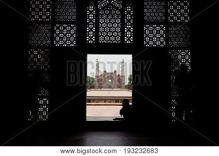 The entrance of the Sikandra monument or Akbar tomb in Agra where Akbar the Great is buried. A World heritage site. A red sandstone architecture gate with intricate mughal carvings.