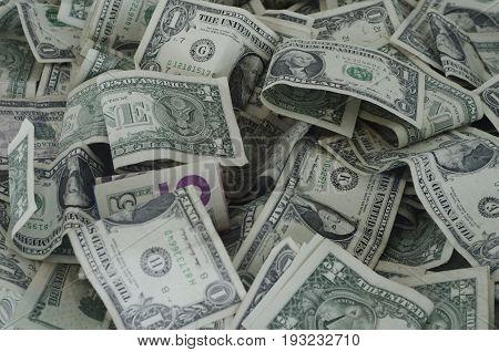 Big stack of random dollar bills on top of eachother