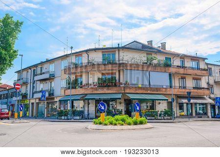 PADOVA, ITALY - May, 24, 2017: Flower-pot infront of inhabitable house in Padova, Italy
