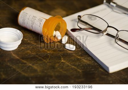 perscription pills spilling out of their container