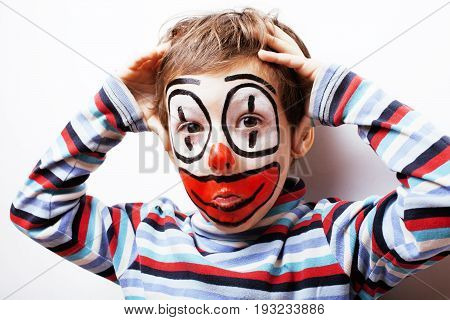 little cute real boy with facepaint like clown, pantomimic expressions close up