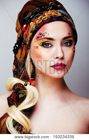 portrait of contemporary noble woman with face art creative close up, russian style fashion