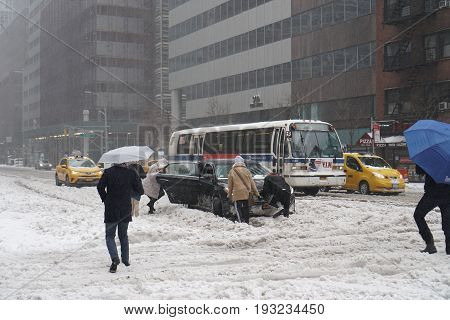 March 14, 2017, Manhattan, New York City, USA - Car stuck in snow during snow blizzard in Manhattan, New York City,