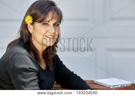 Middle Aged Woman With Dandelion Flower In Hair