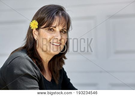 Middle Aged Woman Smiling While Looking At Camera