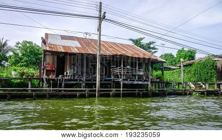 Slum House On The River Bank In Bangkok, Thailand