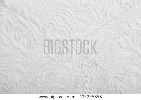 Knitwear fabric with floral tender white abstract volume pattern.