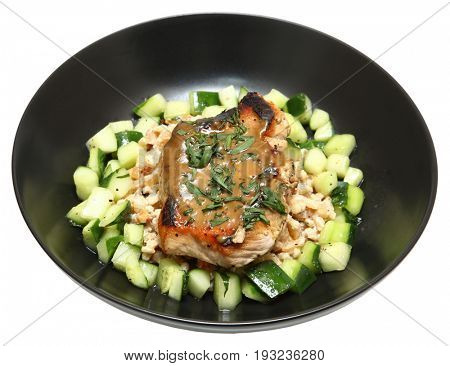 Pork Chops with Creamy Barley Salad plated with a cucumber and squash salad topped with a honey mustard sauce and tarragon.