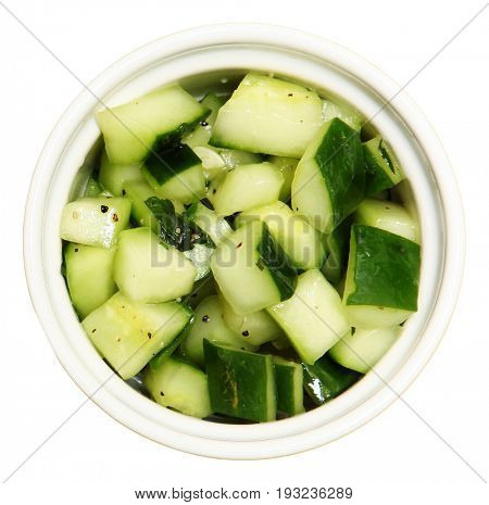 Bowl of seasoned Marinated Cucumbers side dish.