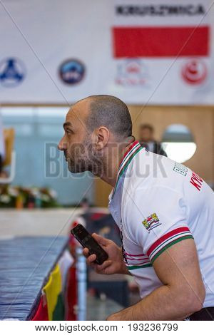 BERLIN - MARCH 18 2017: Emotions of the team coaches during the sparring. European championship Kyokushin World Union (KWU) for Children and Youth.