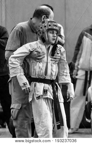 BERLIN - MARCH 18 2017: First aid to a fighter. Black and white. European championship Kyokushin World Union (KWU) for Children and Youth.