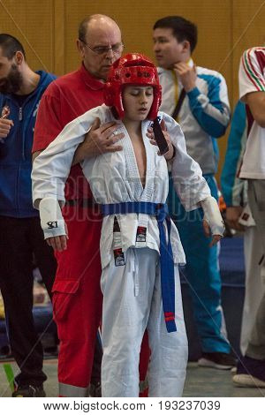 BERLIN - MARCH 18 2017: First aid to a fighter. European championship Kyokushin World Union (KWU) for Children and Youth.