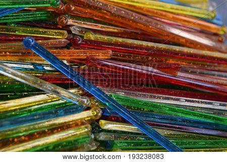 pile of colorful vintage retro glass swizzle sticks